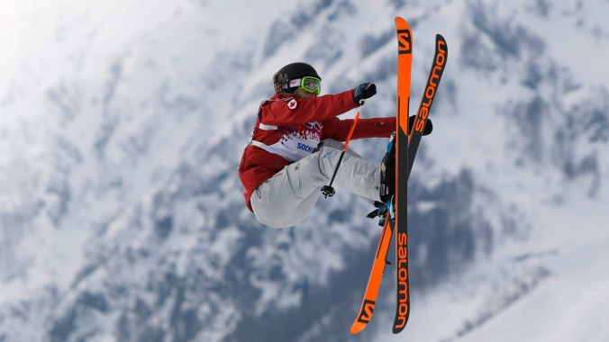 Dara Howell grabs the front of her skis on way to landing the final jump of her winning run at Sochi 2014.