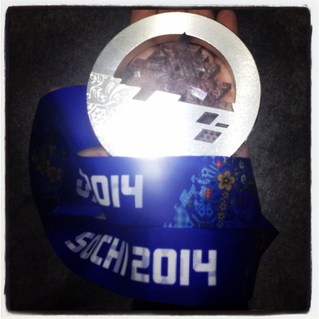 Olympic.ca researcher Paula Nichols holds Denny Morrison's Sochi silver medal.