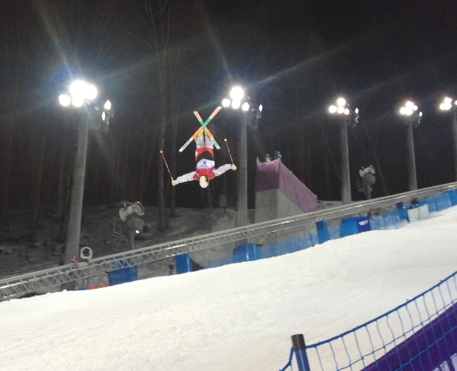 Sideline view of the final jump at the 2014 Sochi women's moguls event at Rosa Khutor Extreme Park. Feb 8, 2014. Photo : Steve Boudreau