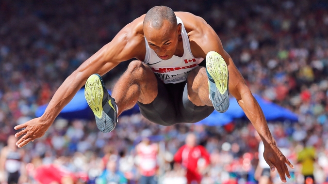 Commonwealth Games Decathlon gold medallist Damian Warner takes flight during the long jump.