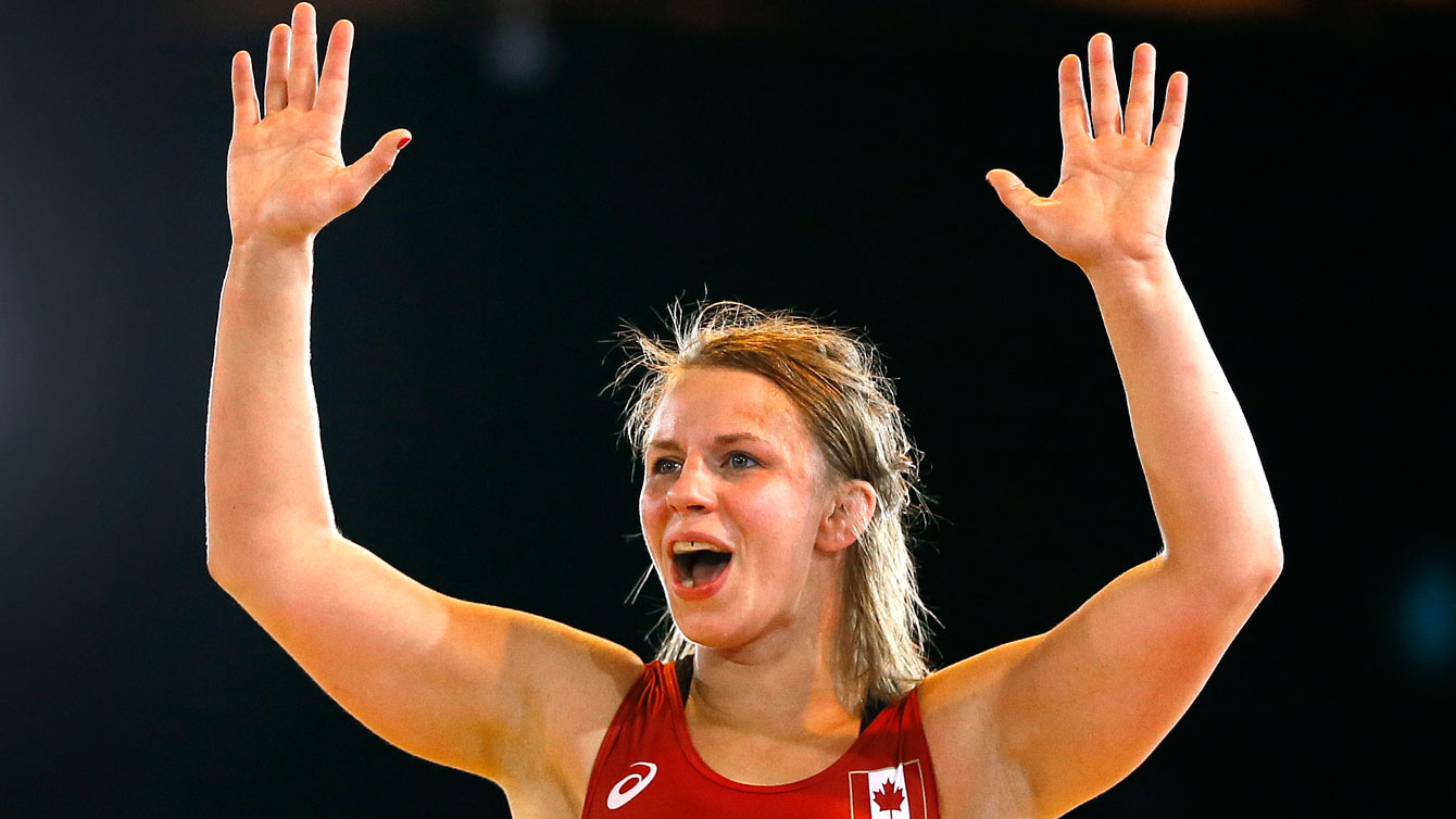 Erica Wiebe celebrates her wrestling gold medal at Glasgow 2014 Commonwealth Games.