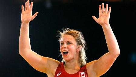 Erica Wiebe celebrates her wrestling gold medal