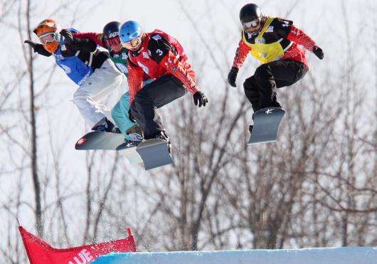 Carle Brenneman (yellow) grabs air during a World Cup race. (Photo: Canadian Press)