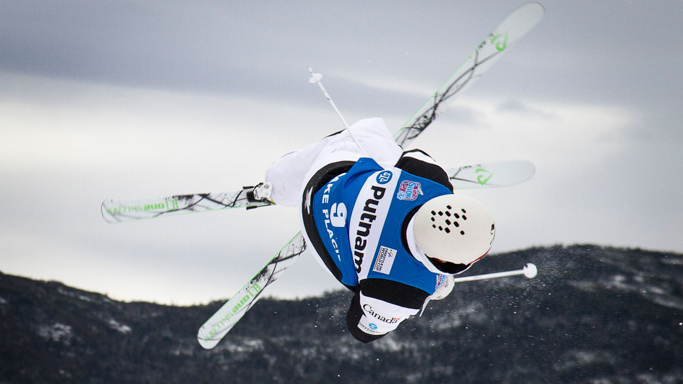 Marc-Antoine Gagnon flies through the air at Moguls World Cup at Lake Placid. Photo: Evan Spinosa