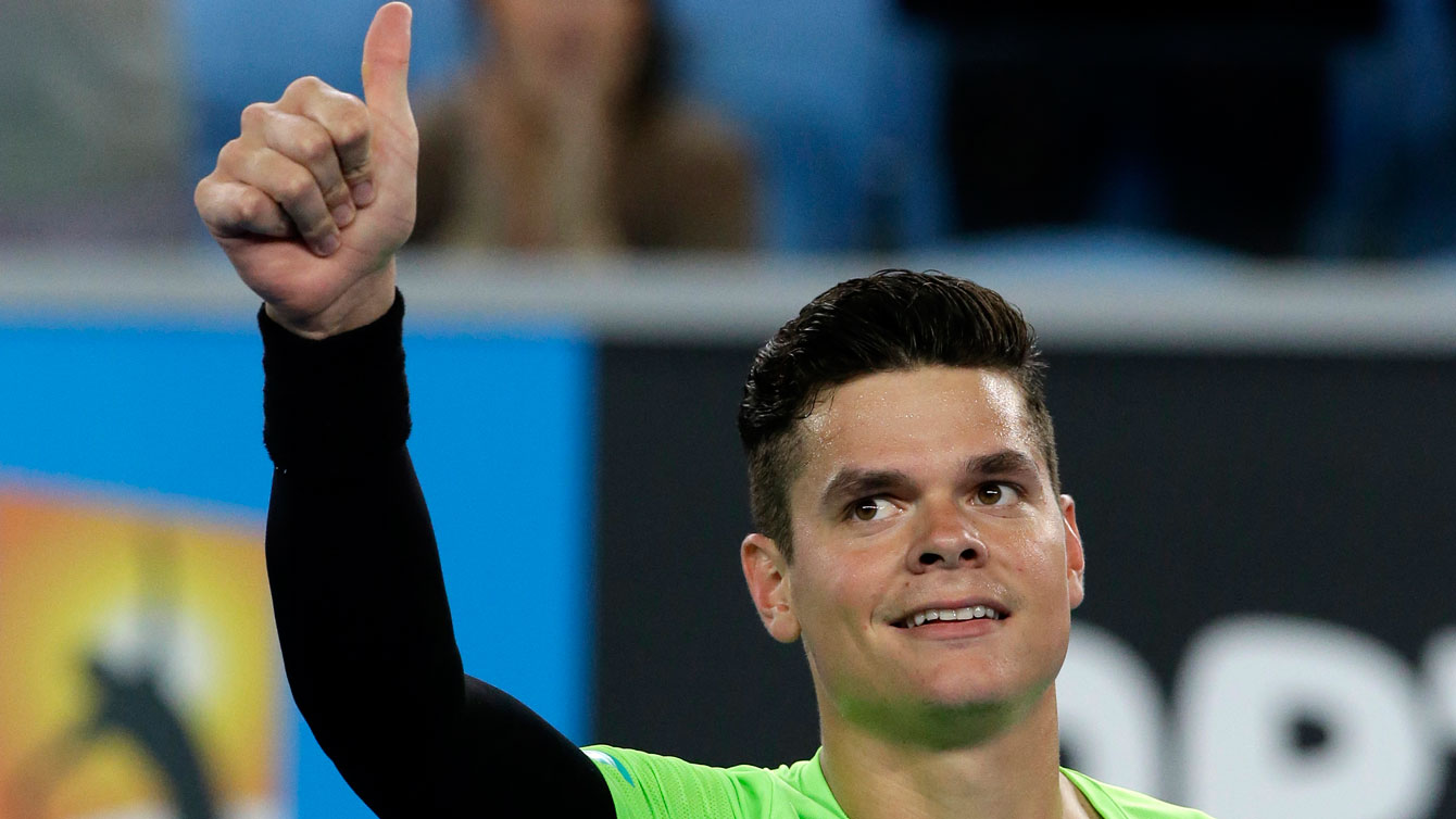 Milos Raonic gives a thumbs up after winning a match at the 2015 Australian Open.