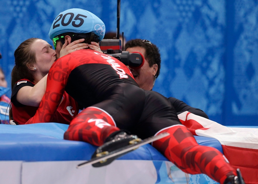 Charles Hamelin and girlfriend Marianne St-Gelais celebrate.