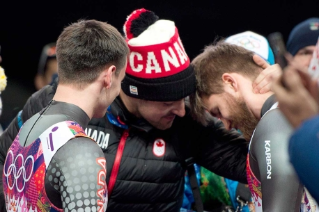 Sam Edney comforts doubles luge teammates Justin Snith (L) and Tristan Walker (R) (Sochi)