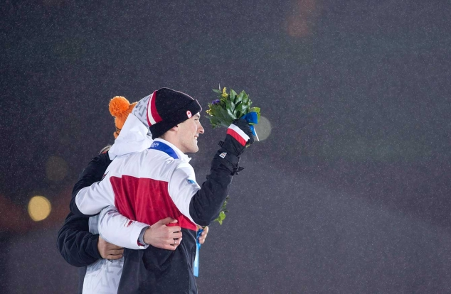 Denny Morrison and competitors at the victory ceremony in Sochi.