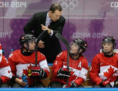 Head coach Kevin Dineen gives direction in Sochi.