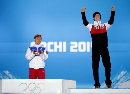 Charle Cournoyer (R) won the 500m bronze medal in short track.