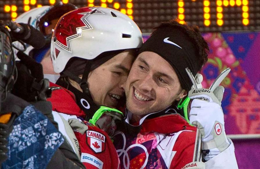Mikaël Kingsbury (L) and Alex Bilodeau (R) celebrate after their moguls triumph.