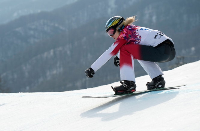 Dominique Maltais during snowboard cross competition at Sochi 2014.