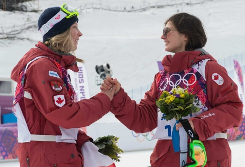 Dara Howell (L) and Kim Lamarre (R) celebrate their gold and bronze medals during the flower ceremony for ski slopestyle.