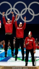 Canadian speed skaters Denny Morrison, left, Lucas Makowsky and Mathieu Giroux, right, celebrate their gold medal in the men's team pursuit long track speed skating race Saturday February 27, 2010 the 2010 Vancouver Olympic Winter Games in Vancouver. THE CANADIAN PRESS/Robert Skinner