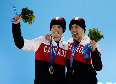 Mikaël Kingsbury (L) and Alex Bilodeau (R) on the podium in Sochi.
