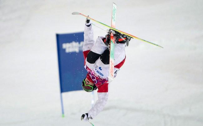 Alex Bilodeau during a moguls run at Sochi 2014.