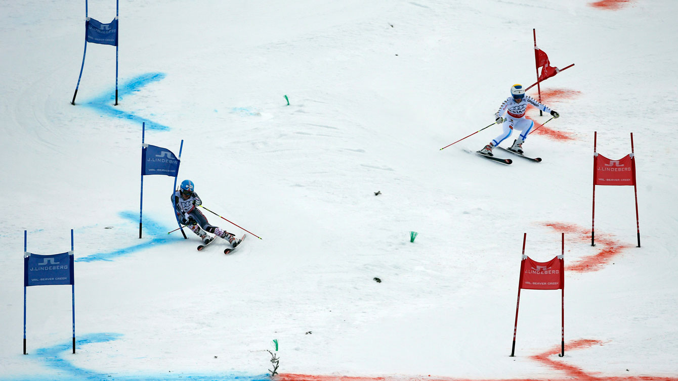 Erin Mielzynski (left) ahead of her Swedish opponent in the mixed team event at the 2015 FIS Alpine World Ski Championships.