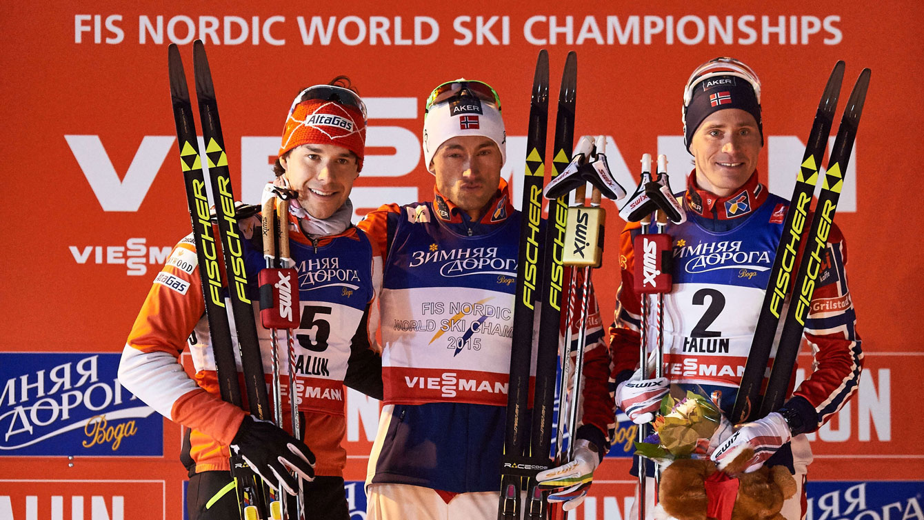 Alex Harvey (left) on the 2015 World Championship podium in Falun, Sweden for silver in men's sprint.