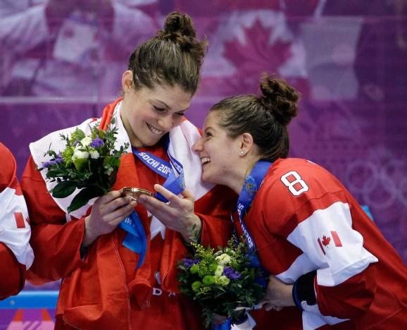 Rebecca Johnston (L) and Laura Fortino (R) celebrate in Sochi.
