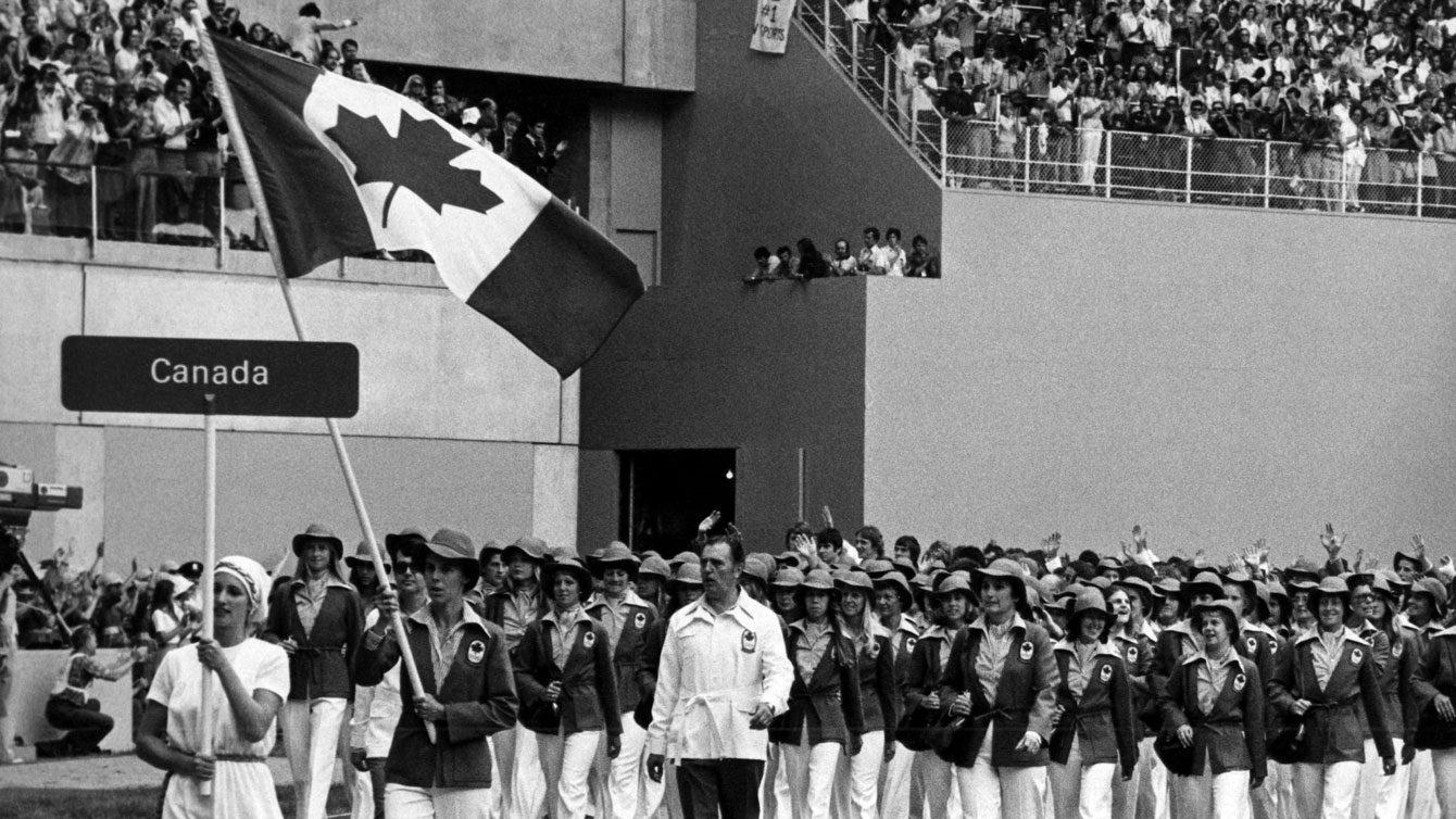 Abby Hoffman carries the Canadian flag into Olympic Stadium at Montreal 1976.