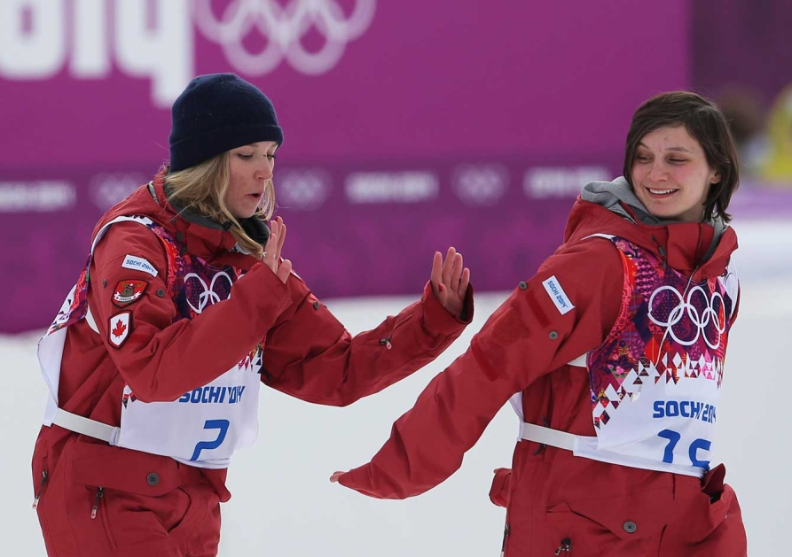 Dara Howell (L) and Kim Lamarre (R) on their way to the flower ceremony in Sochi.