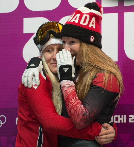 Kaillie Humphries and Heather Moyse await the results of bobsleigh competition in Sochi.