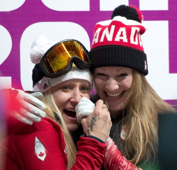 Kaillie Humphries and Heather Moyse react as it becomes clear they successfully defended their Olympic title at Sochi 2014.