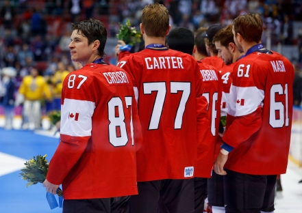 Men's ice hockey team captain Sidney Crosby looks around during the medal ceremony.