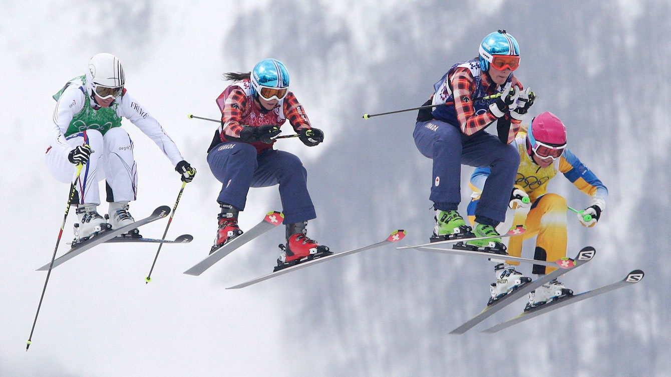 Marielle Thompson (middle right) and Kelsey Serwa (middle left) fly through the air before finishing 1-2 in ski cross.