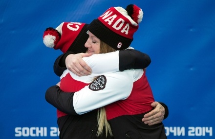 Kaillie Humphries and Heather Moyse at the victory ceremony for bobsleigh in Sochi.