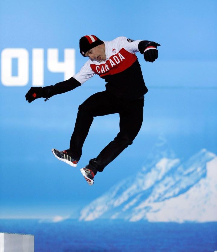 Denny Morrison hops onto the podium in Sochi.