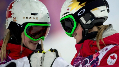 Fist bump! The Dufour-Lapointe sisters celebrate their gold-silver performance.