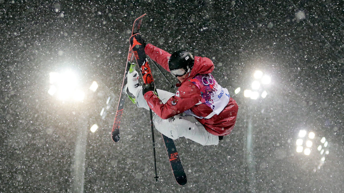 Mike Riddle during one of his runs in heavy snow at the Sochi ski halfpipe competition.