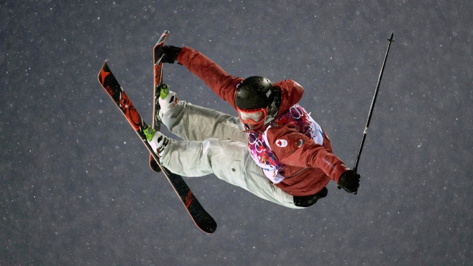 Mike Riddle in action at the ski halfpipe competition at Sochi 2014