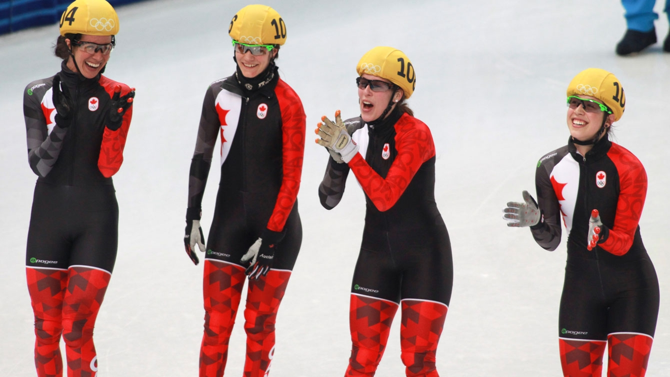 (L-R) Marie-Ève Drolet, Jessica Hewitt, Marianne St-Gelais, Valérie Maltais celebrate after learning they won a silver medal in the women's 300m relay.