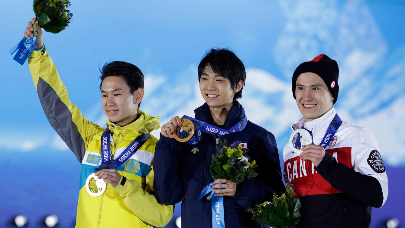 Denis Ten (left) shares a Sochi medal podium with Canada's Patrick Chan (right).