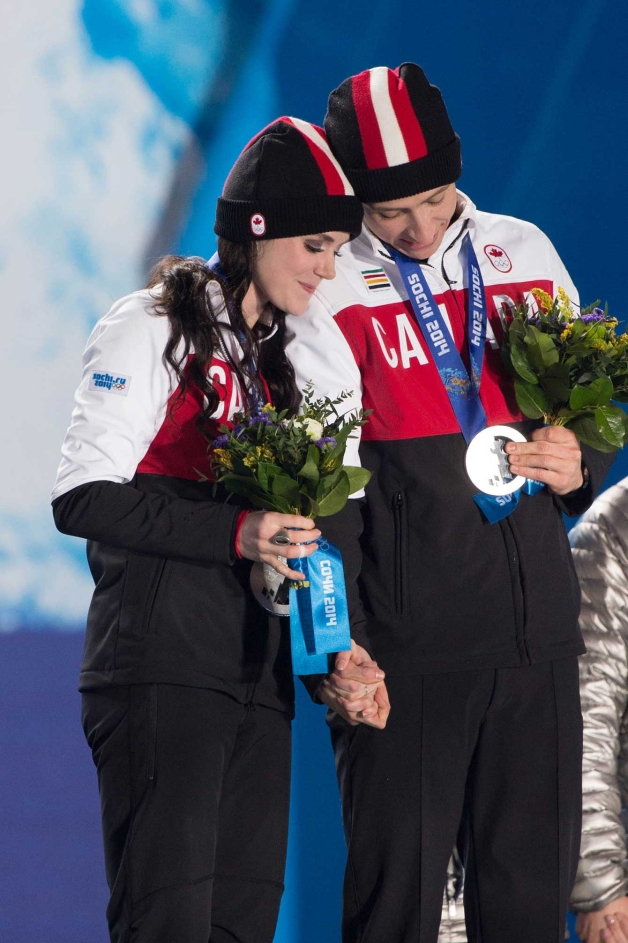 Tessa Virtue and Scott Moir at the victory ceremony for ice dance in Sochi.
