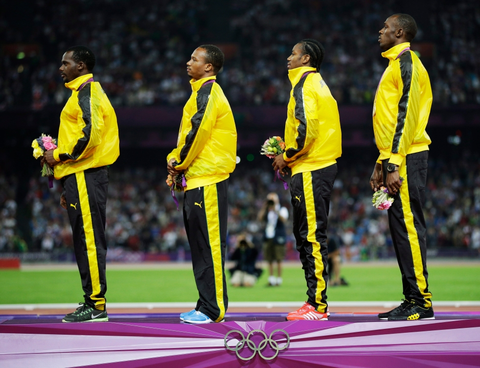 Usain Bolt (right), Yohan Blake (second right), and their Jamaican teammates at London 2012.