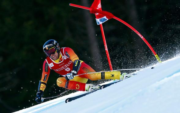 Dustin Cook speeds down the Super-G course in Kvitfjell, Norway, Sunday, March 8, 2015. (AP Photo/Alessandro Trovati)
