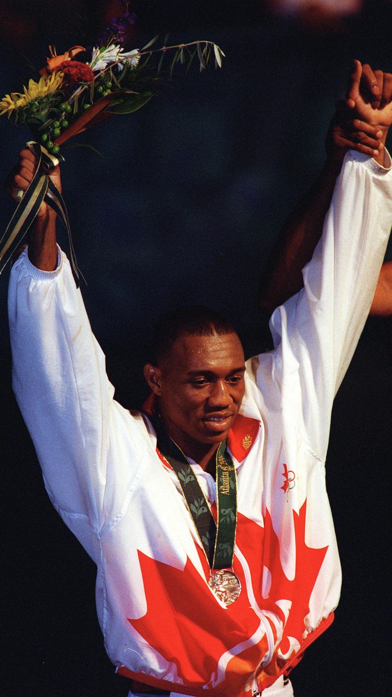 David Defiagbon receives his Olympic medal at Atlanta 1996.