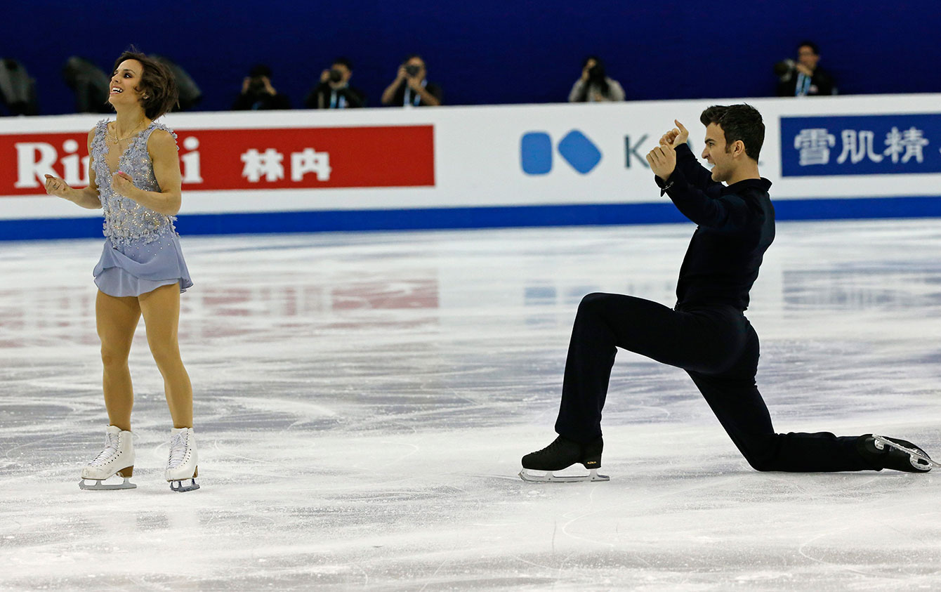 Meagan Duhamel and Eric Radford after their pairs short program at  the ISU World Figure Skating Championship 2015 held at the Oriental Sports Centre in Shanghai, China, Wednesday, March 25, 2015.