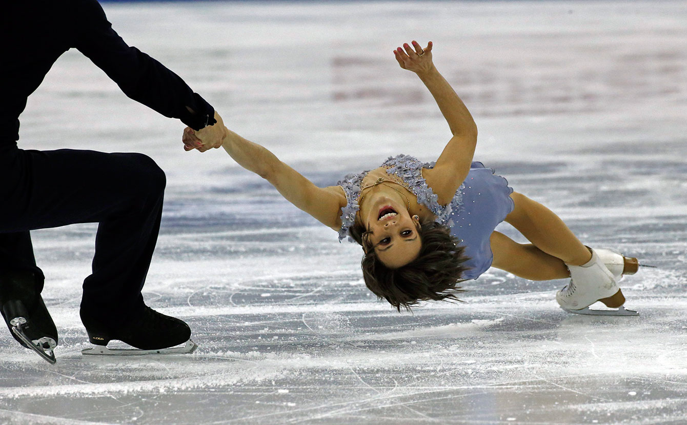 Meagan Duhamel and Eric Radford during their pairs short program at  the ISU World Figure Skating Championship 2015 held at the Oriental Sports Center in Shanghai, China, Wednesday, March 25, 2015.