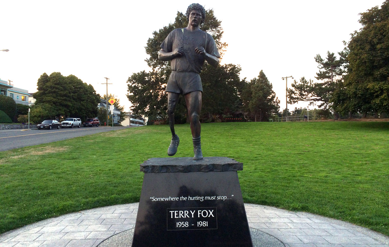 """Terry Fox statue in Victoria, BC steps from the Pacific Ocean with the inscription """"Somewhere the hurting must stop..."""" Fox would have ended his Marathon of Hope on the Pacific Ocean after starting from the Atlantic."""