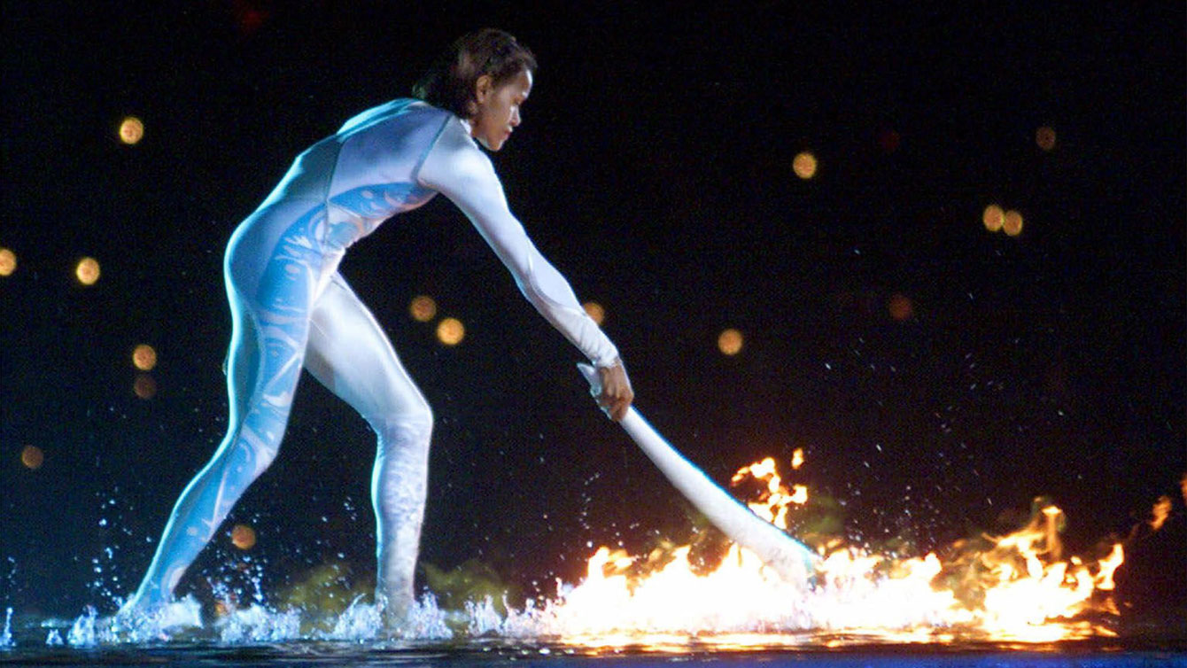 Cathy Freeman ignited the Olympic Flame before she won gold in the 400m.