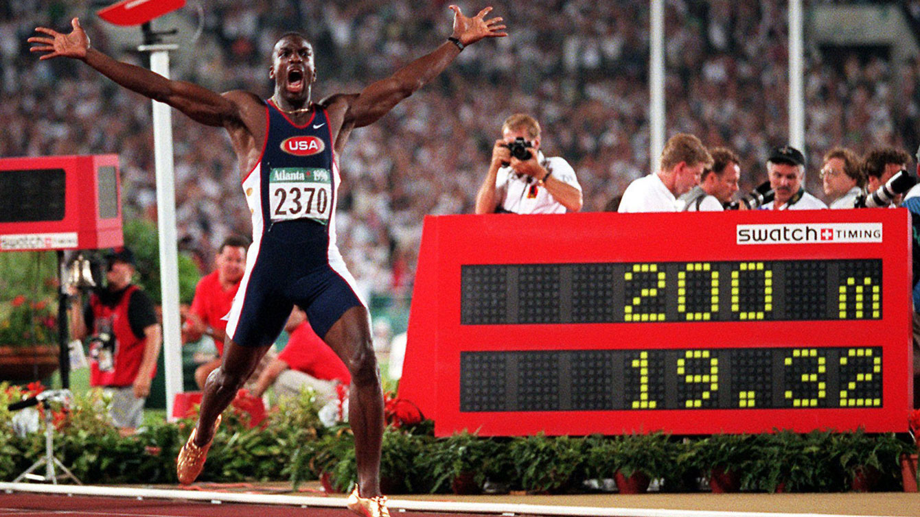 Michael Johnson celebrates setting the 200m World Record, shattering and resetting his own previous best from 19.66 to 19.32.