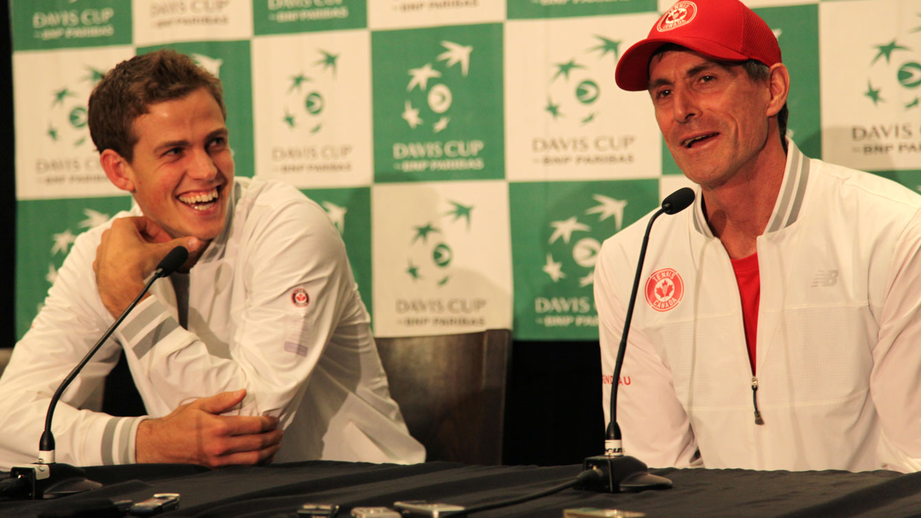 Vasek Pospisil (left) with team captain Martin Laurendeau following the conclusion of the Japan Davis Cup tie in Vancouver.