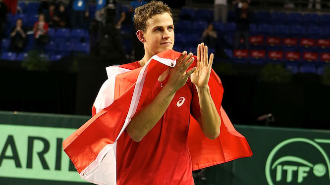 Vasek Pospisil did a victory lap with the Canadian flag following his 2015 Davis Cup fifth rubber win over Japan's Go Soeda.