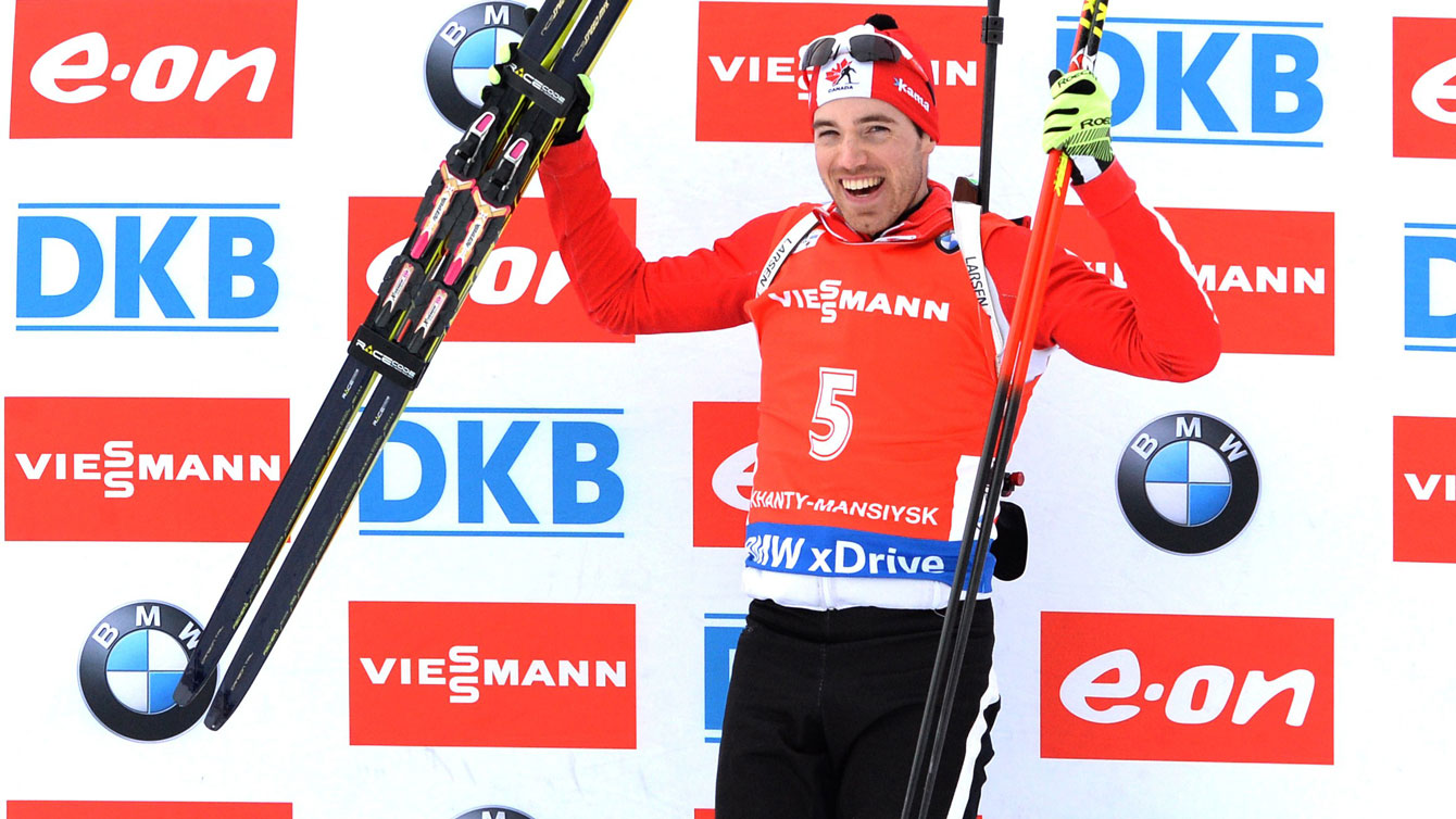 Nathan Smith celebrates atop the World Cup biathlon podium in Russia, March 21, 2015.