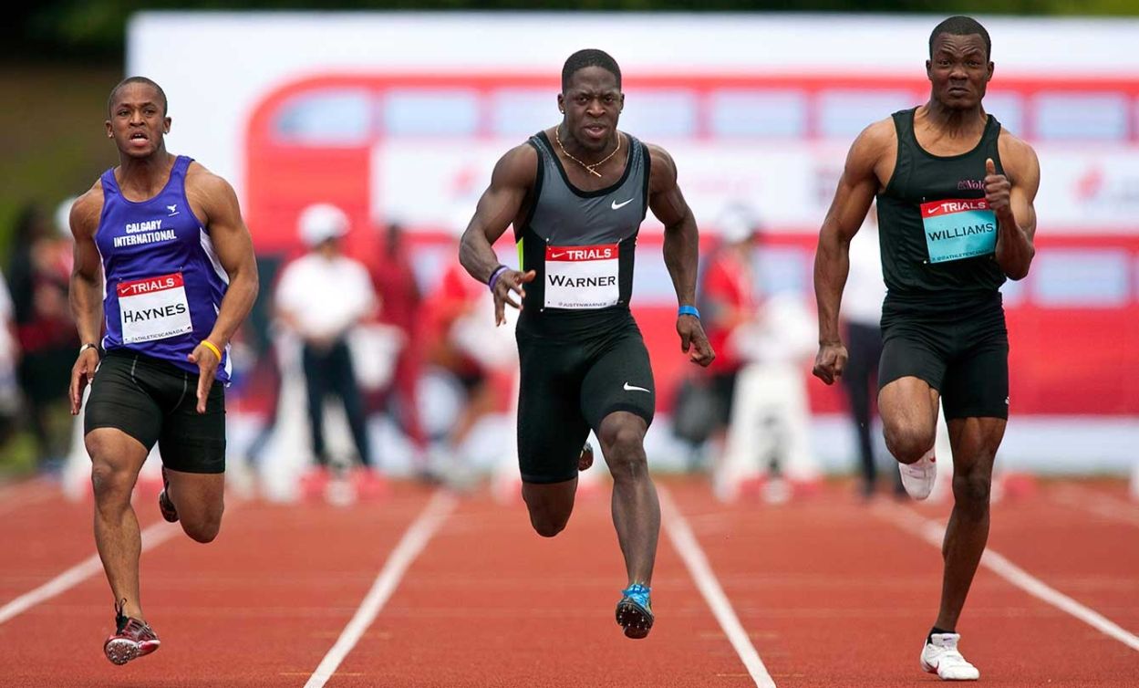 Olympian Justyn Warner (centre) runs in the men's 100m at Canadian Track and Field Championships in Calgary, Alta., Friday, June 29, 2012.THE CANADIAN PRESS/Jeff McIntosh
