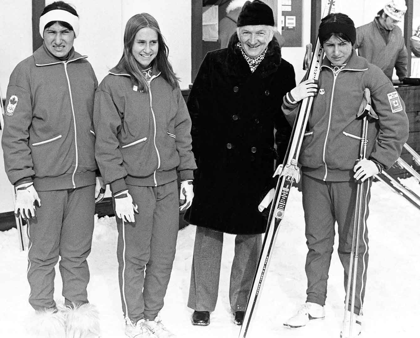 Group photo in black in white. Sharon Firth is holding her skii's